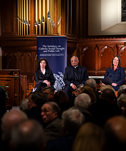 Audience member asks a question to The Francis Factor Today panel in Dahlgren Chapel at Georgetown University