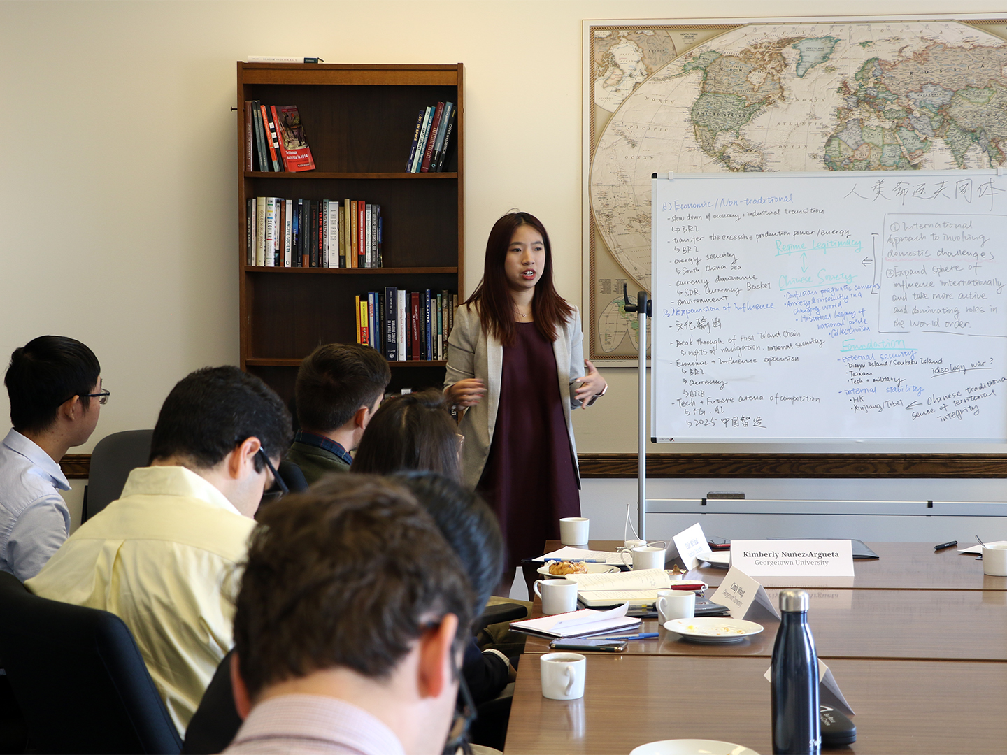 Student Fellow Cindy Wang discussing with the group
