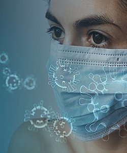 On the left, there are virus. On the right, a woman wearing a mask.