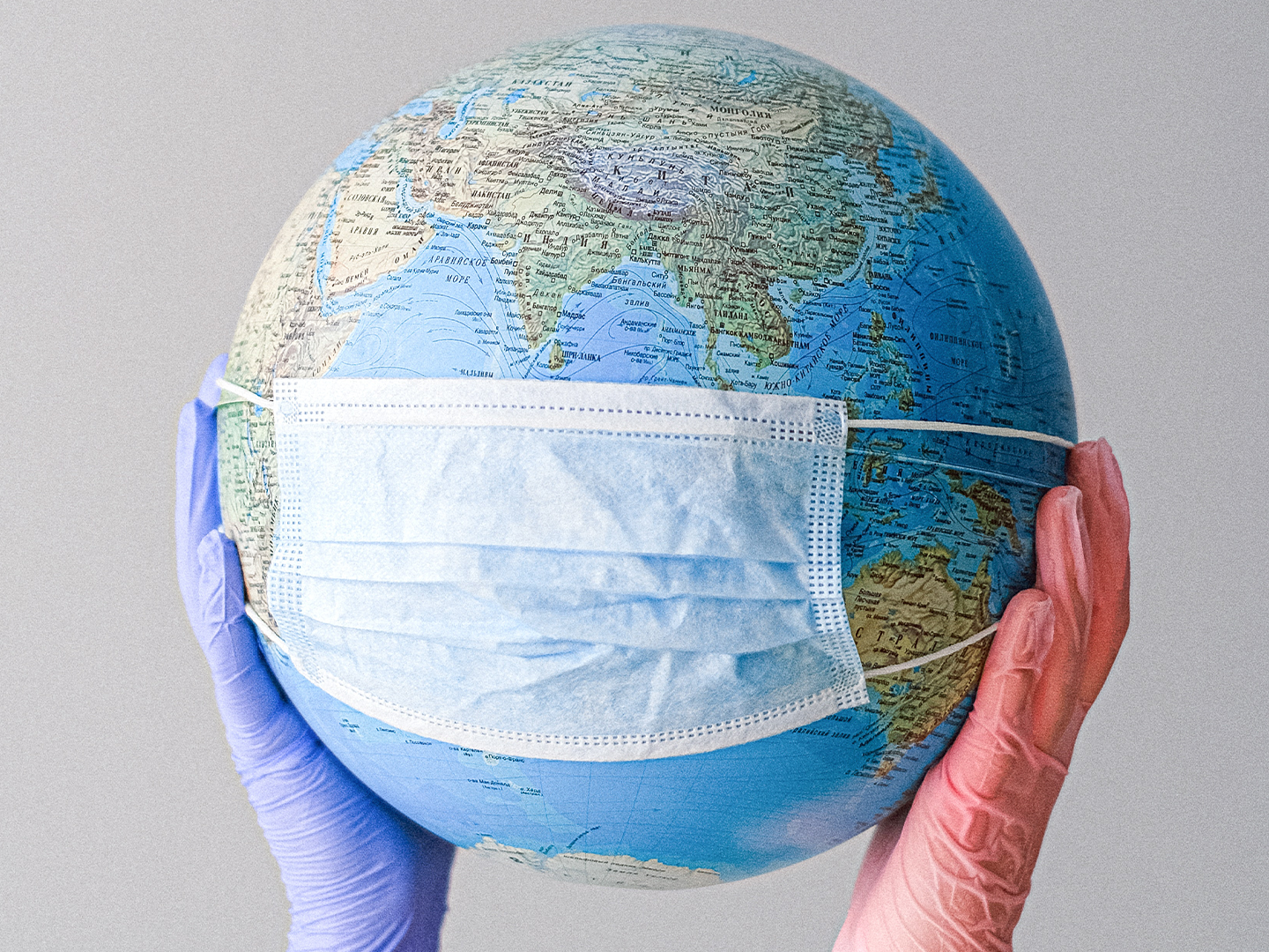 Globe with a mask