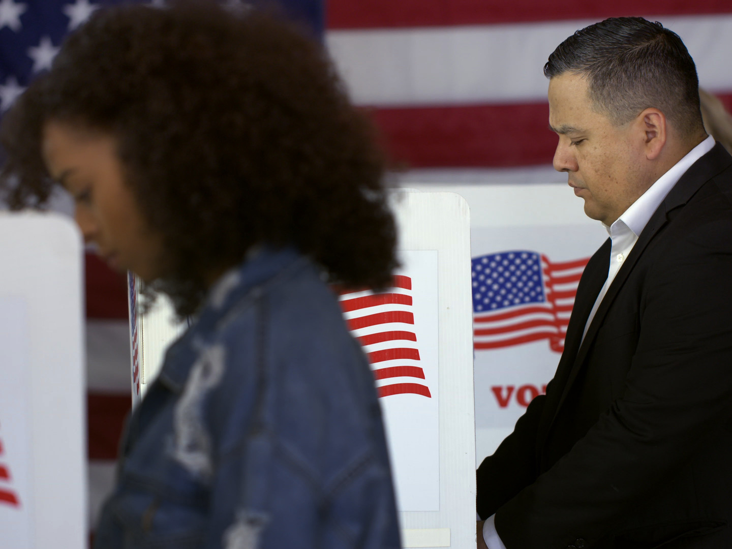 Hispanic man and woman voting in a United States election