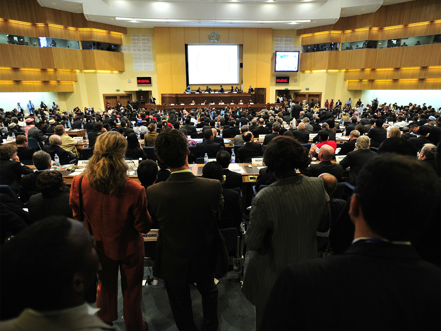 International representatives meet in a large conference hall