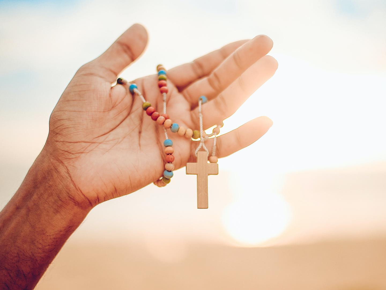 Hand holding rosary