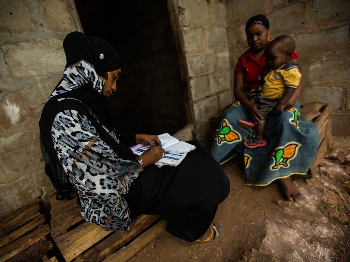 Health worker visits woman and child in Zanzibar (USAID)