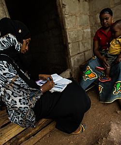 Health worker visits woman and child in Zanzibar (USAID)