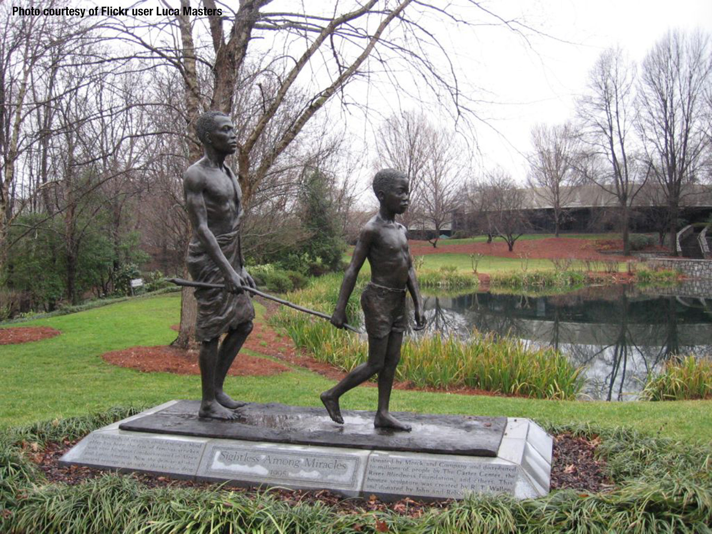 Statue of an African boy leading a blind man with a stick (courtesy of Flickr user Luca Masters)