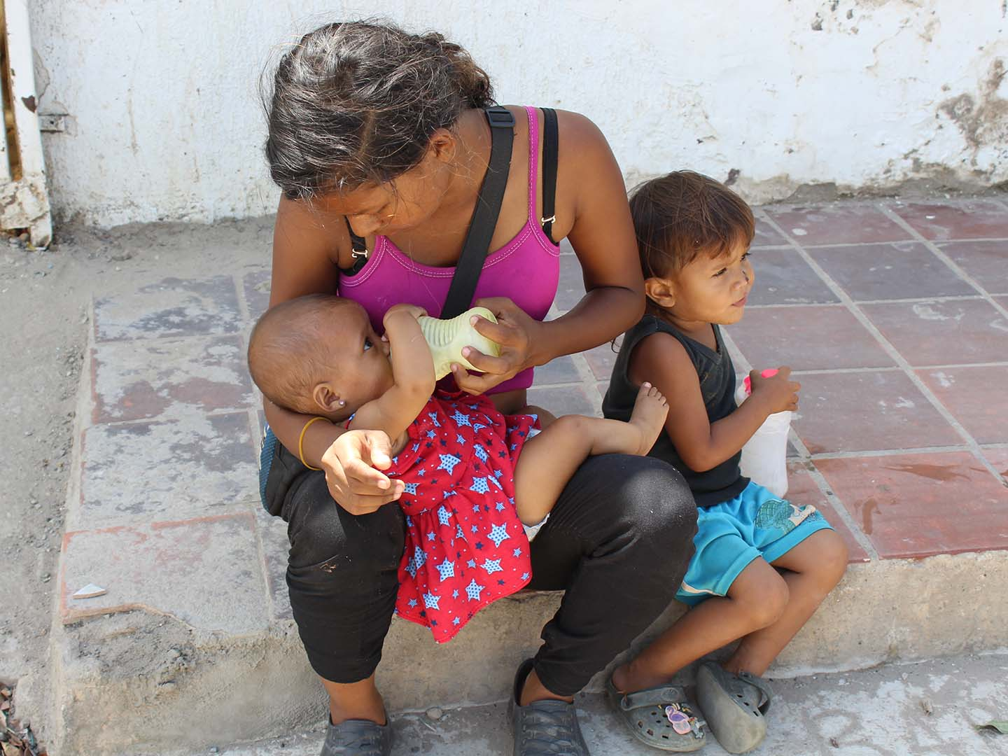 Young immigrant mother with her children