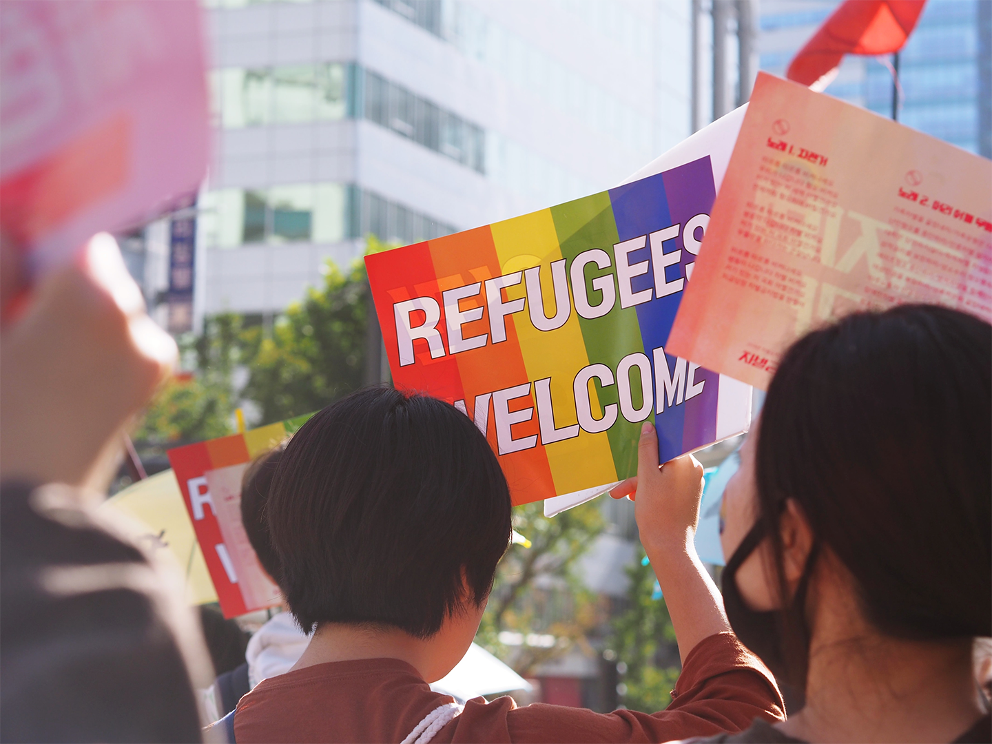 """Protester sign that says """"Refugees Welcome"""""""