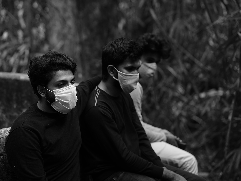 Three people wearing masks