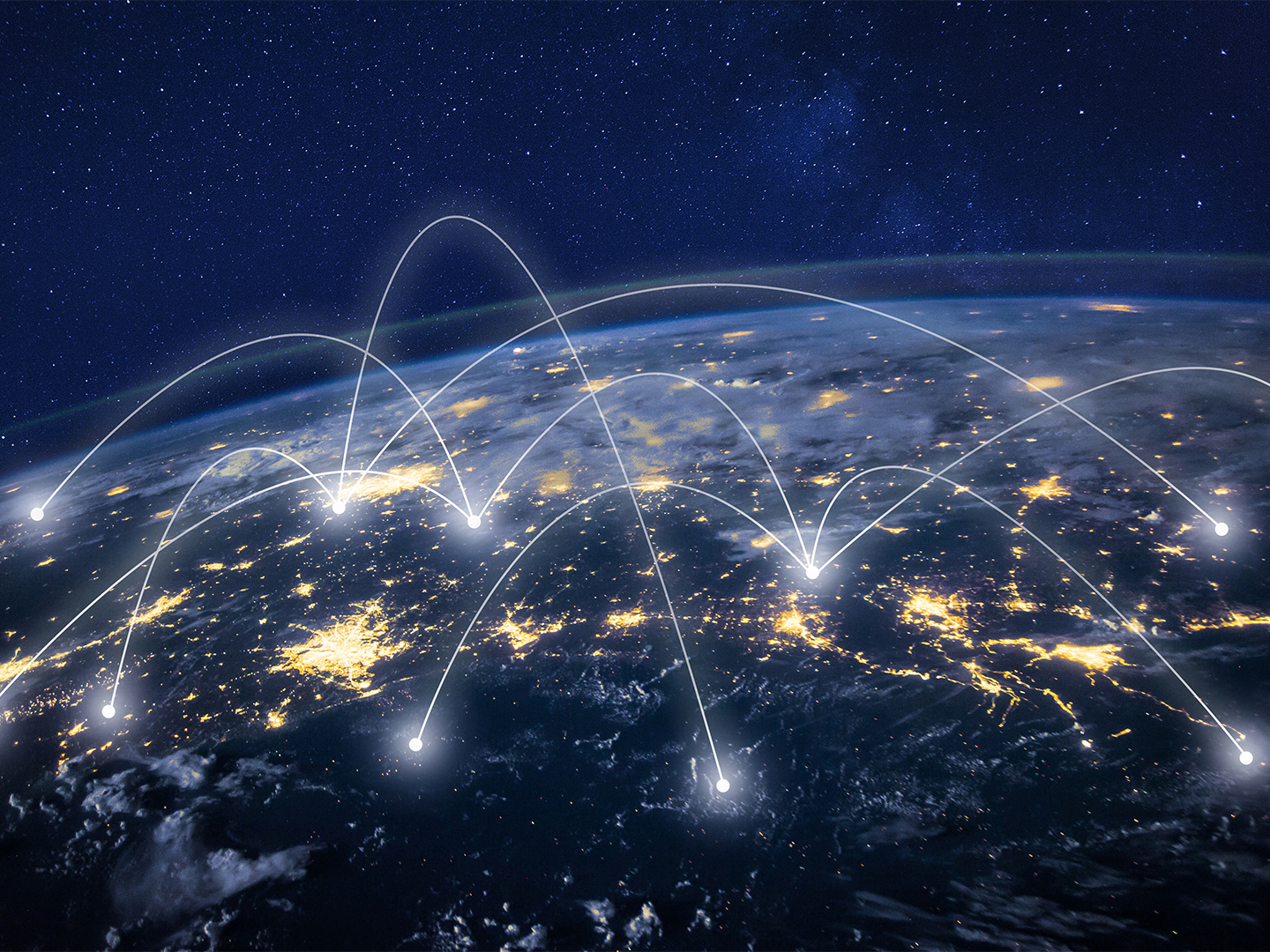 Network connecting across the globe at night