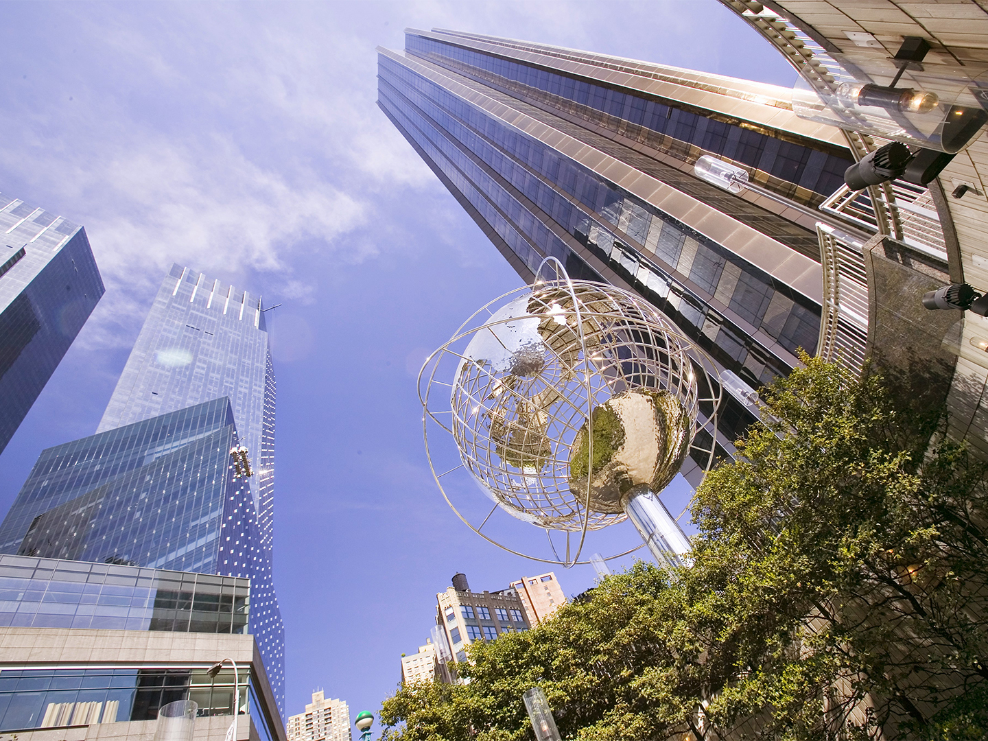 City buildings and globe statue