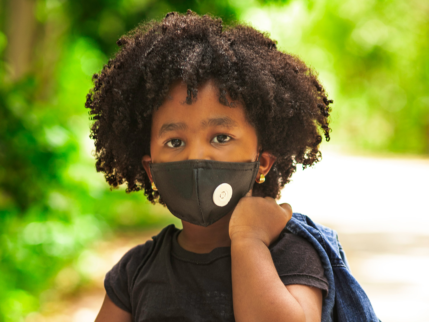A child in the Dominican Republic wears a mask to protect against COVID-19