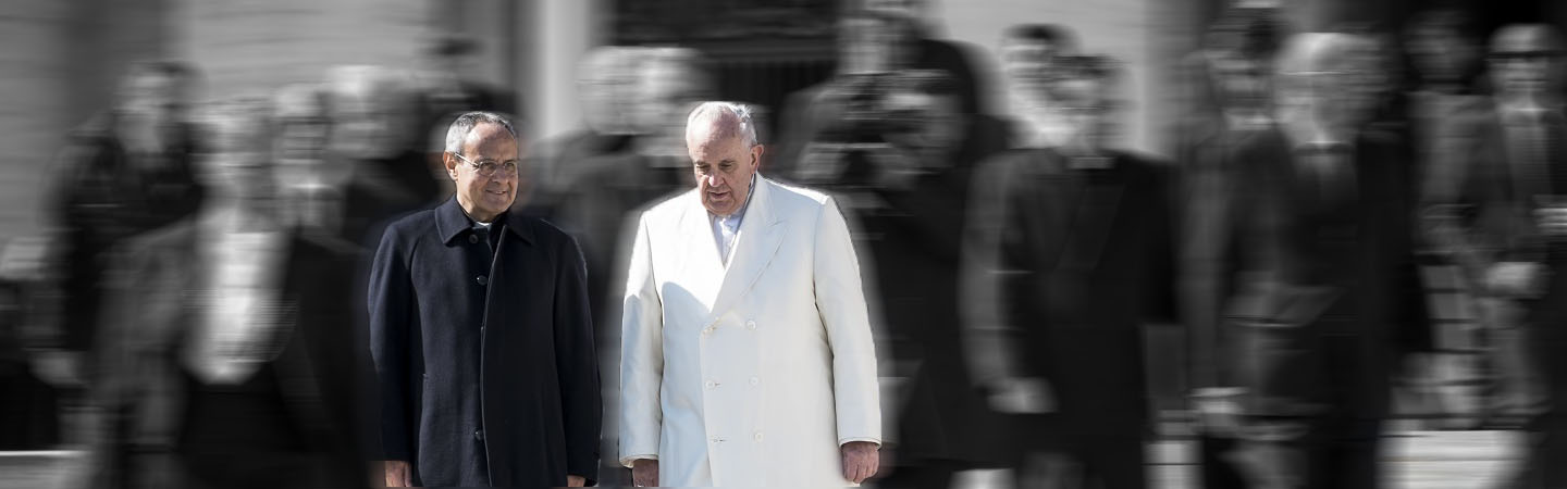 Father Carrón and Pope Francis stand next to each other and the image's background is blurred.
