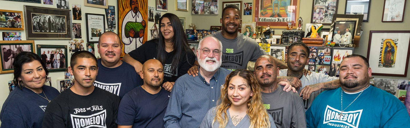Picture of Fr. Greg Boyle with former gang members that are a part of Homeboy Industries.