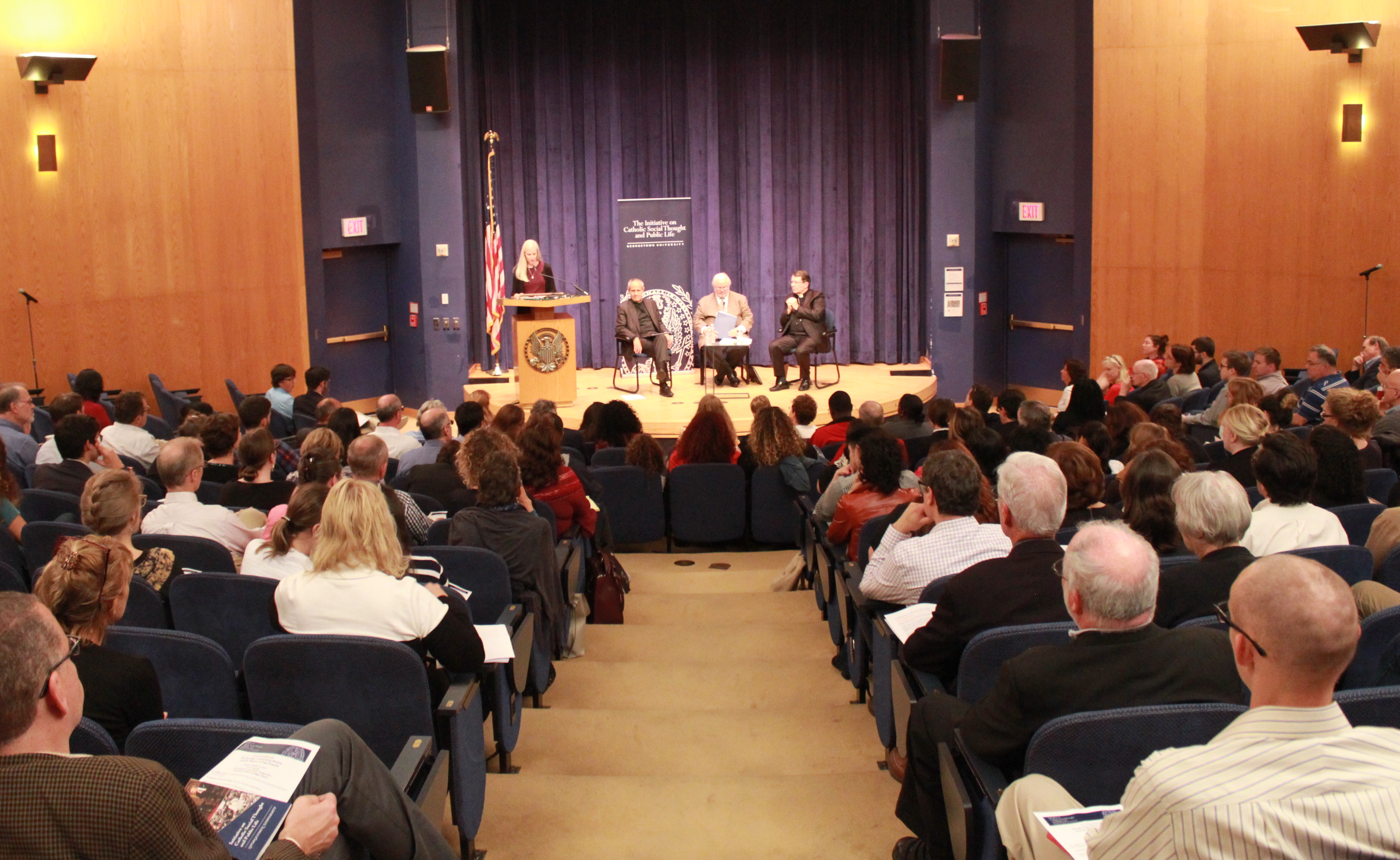 Barbara Gagliotti delivers the opening remarks to a full ICC Auditorium before the panelists begin their discussion.