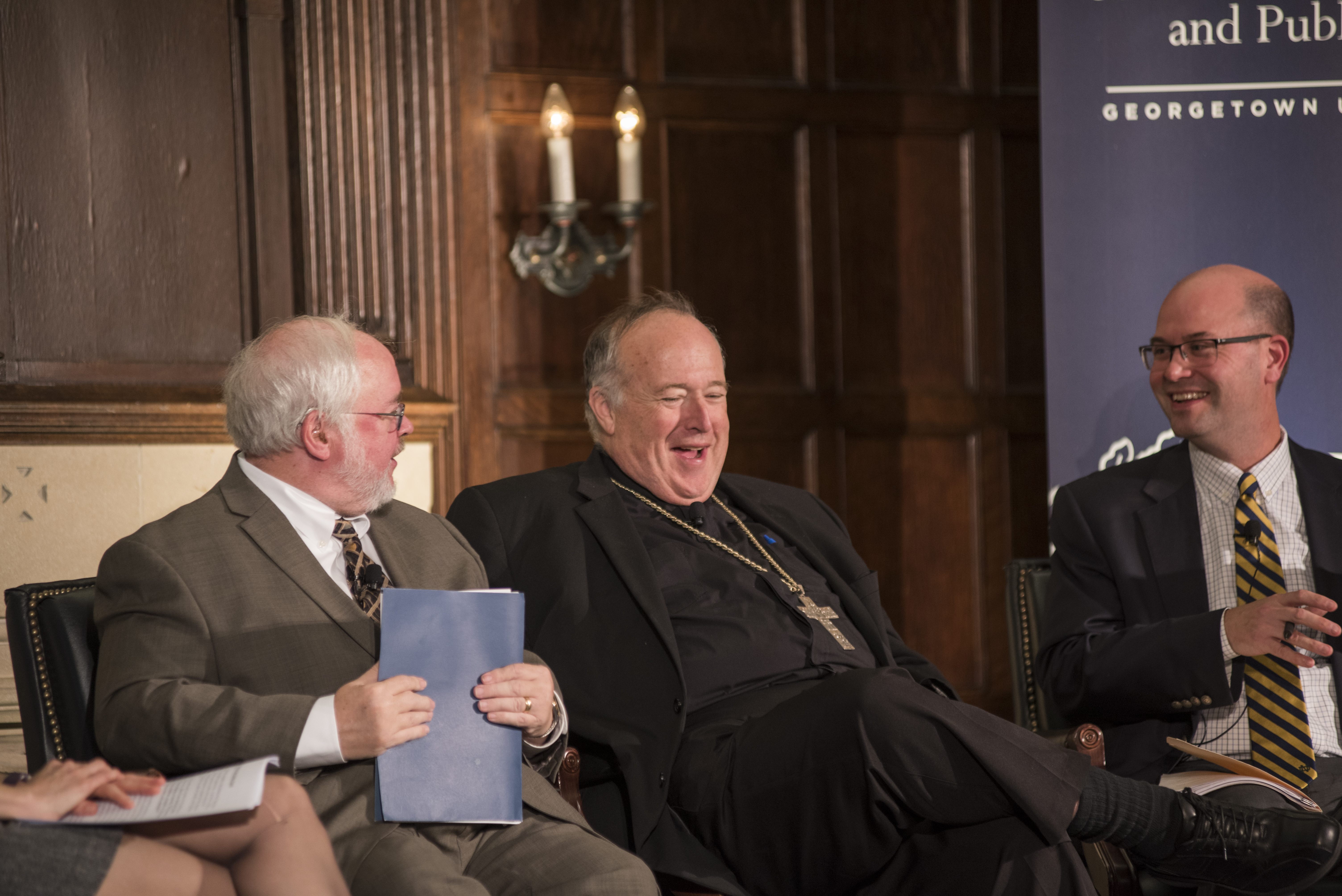 The panel shares a laugh during the conversation!