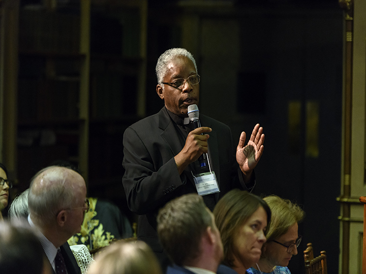 Fr. Kenneth Taylor speaks during an open discussion.