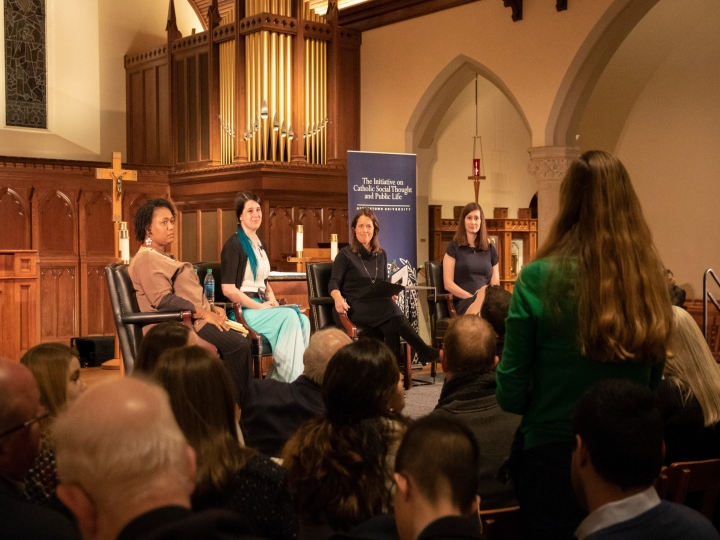 Georgetown student asks a question to the panelists