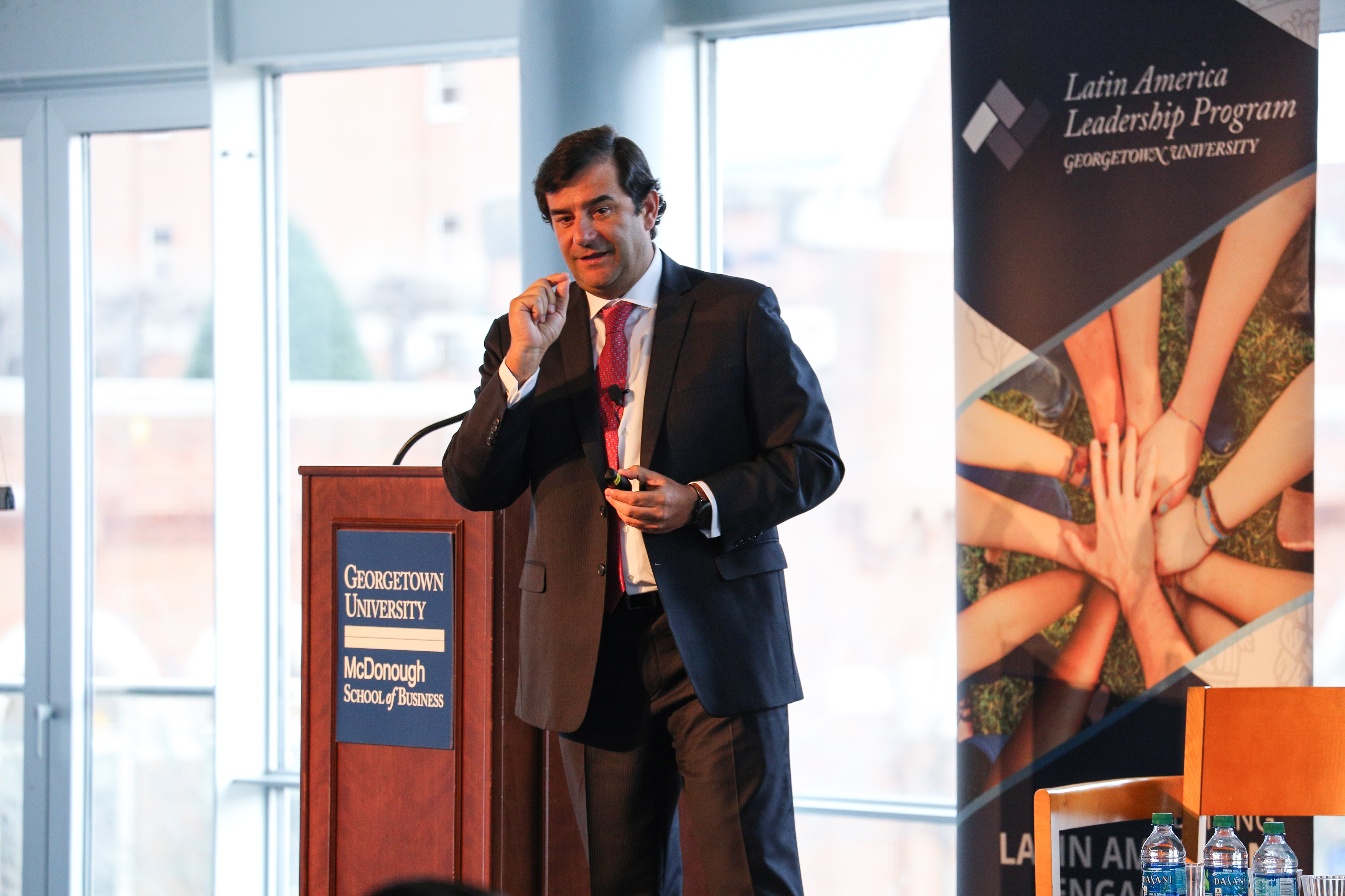 Cesar Cernuda answering questions from the audience