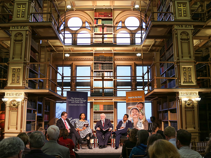 "Panelists of March 25 Public Dialogue on ""The Dignity of Work: Putting Workers at the Center of a Divided Economy"" in Riggs Library."