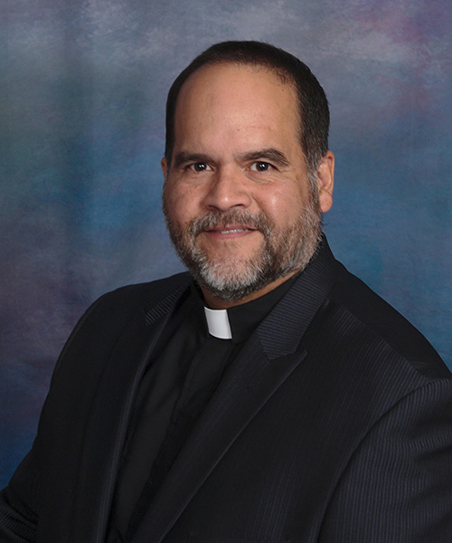 Rev. Carlos Malavé