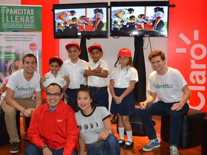 Volunteers and students who benefit from the work of the Fabretto Foundation