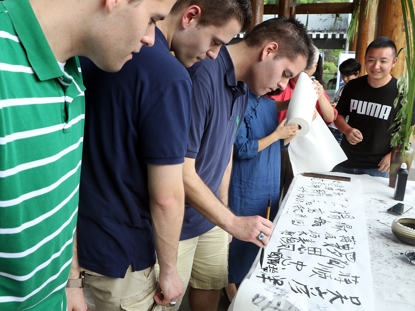 Georgetown Students Practicing Their Chinese Caligraphy in Guiyang.