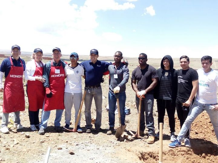 Global Builders and Fuller Center staff, including Carlos Aramayo