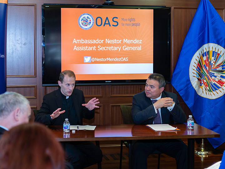 Father Matthew Carnes and Ambassador Nestor Mendez