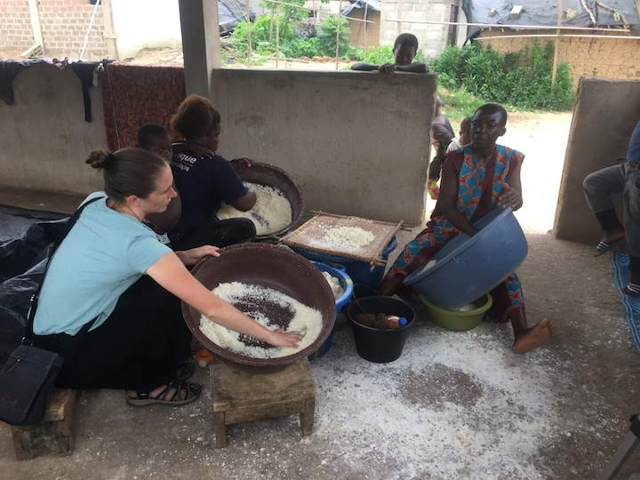 Professor Sande helping to make attieke, a local Ivoirian dish.