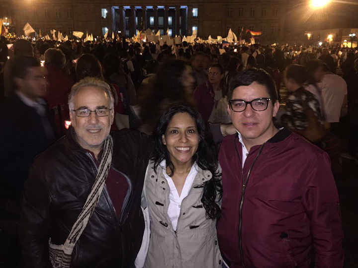 Marc Chernick with Monica Gonzalez (M.A.'11) and Juan Pablo Barrientos (M.A.'10) at a Peace Rally in Plaza Simón 2016