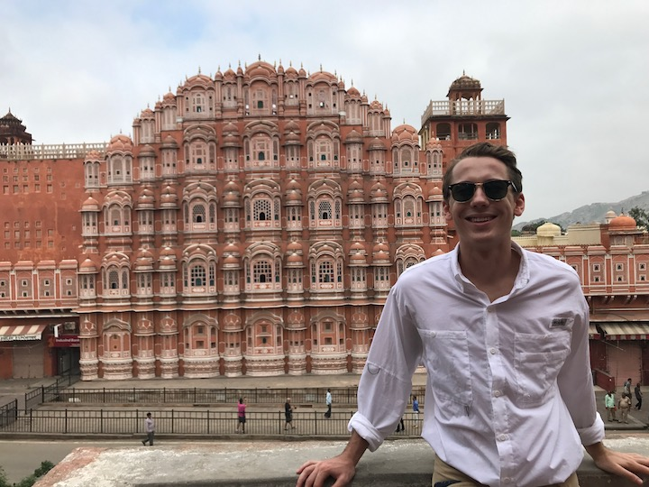 "Henry Mihm (SFS'20) poses in front of the Hawa Mahal (""Wind Palace"") in Jaipur, India."