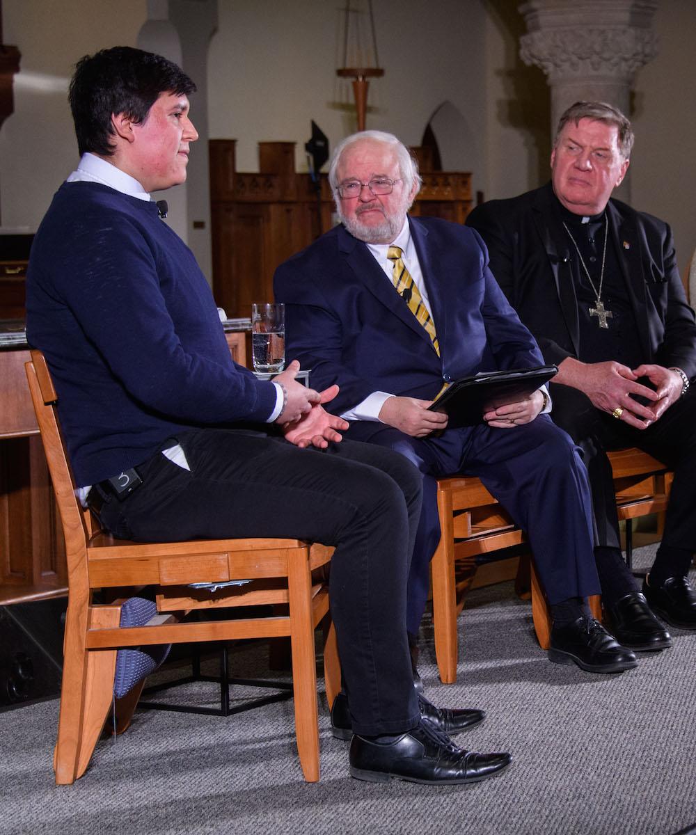 Mizraim Belman Guerrero with CST Director John Carr and Cardinal Tobin listening intently.