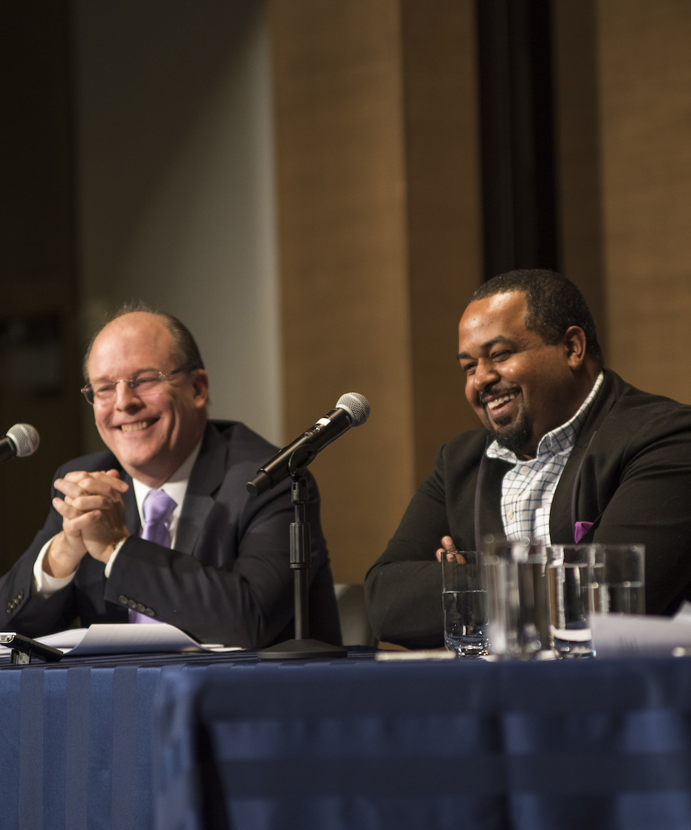 Peter Wehner and Joshua DuBois share a laugh during the conversation.