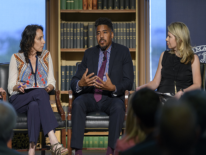 Terrence Johnson speaks during a panel with Michelle Boorstein and  Cherie Harder.