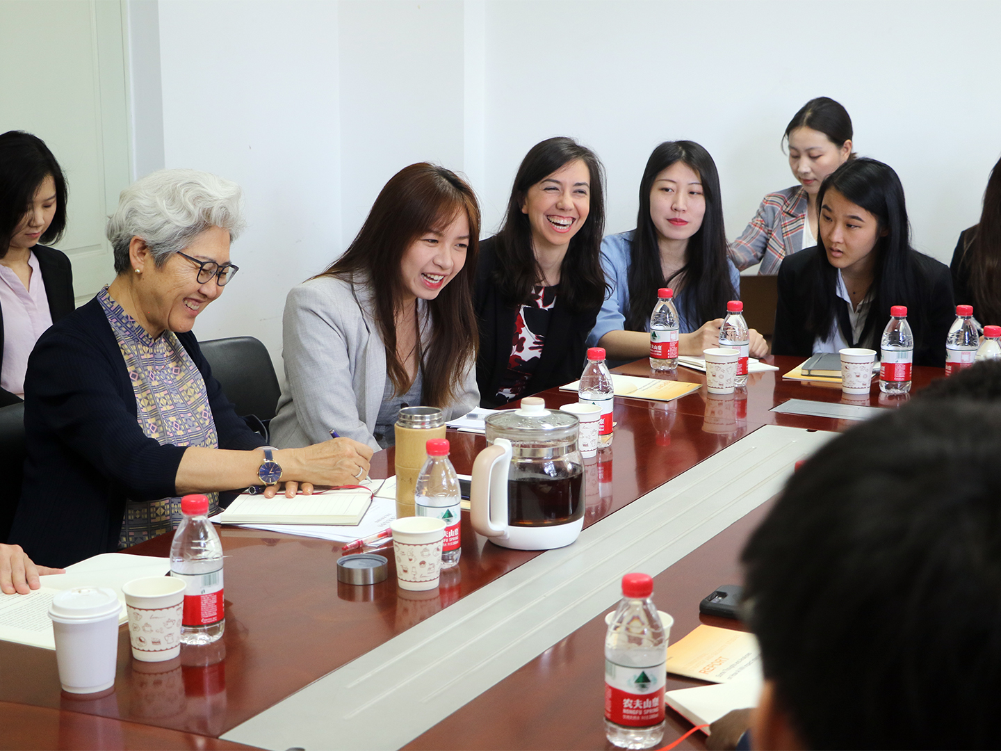 Madame Fu Ying sharing a laugh with the student fellows.
