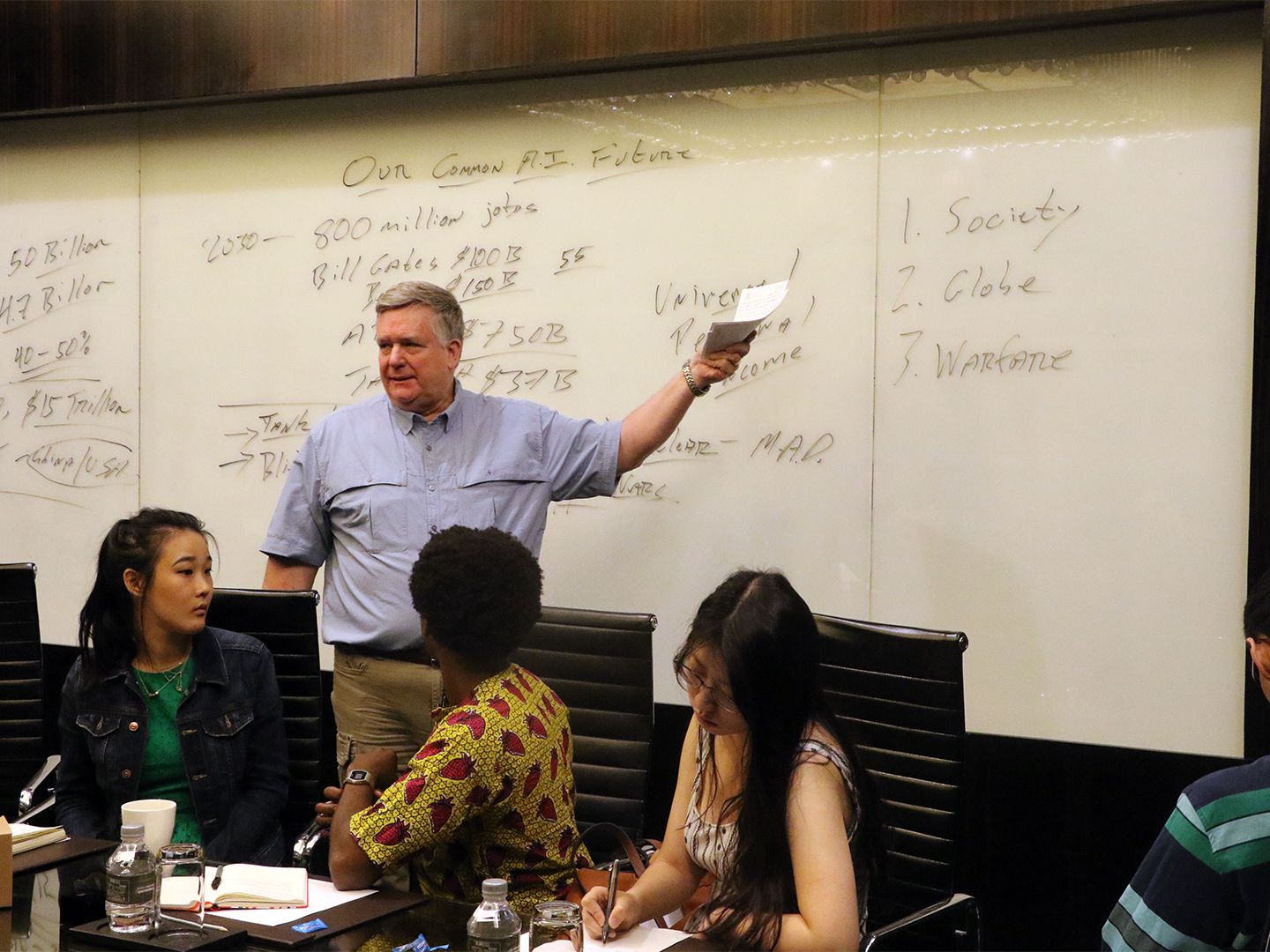 Professor Dennis Wilder asks the student fellows to define the values of their generations.