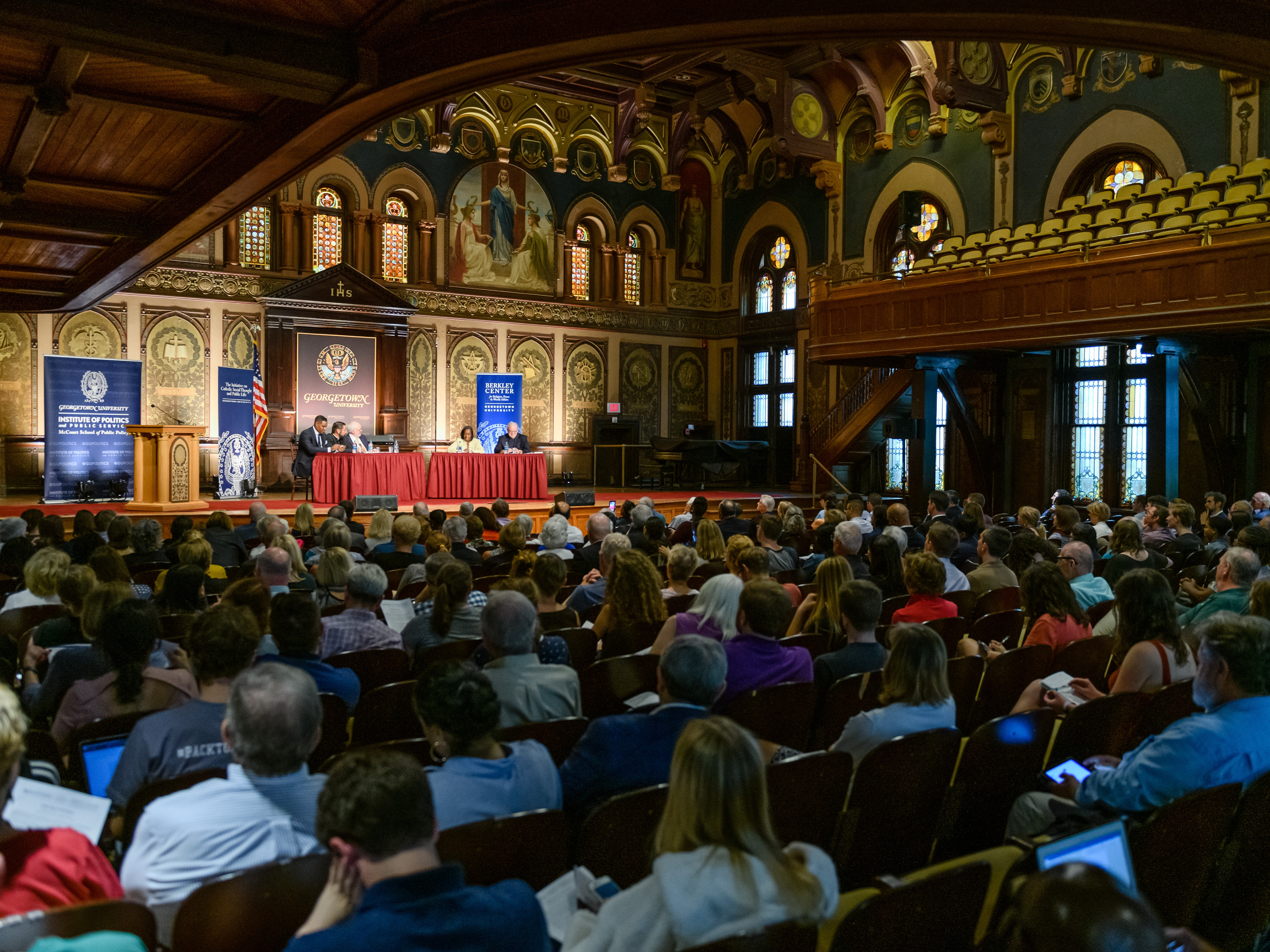 "A full audience in Gaston Hall listens to the Public Dialogue on ""Faith, Race, and Politics."""