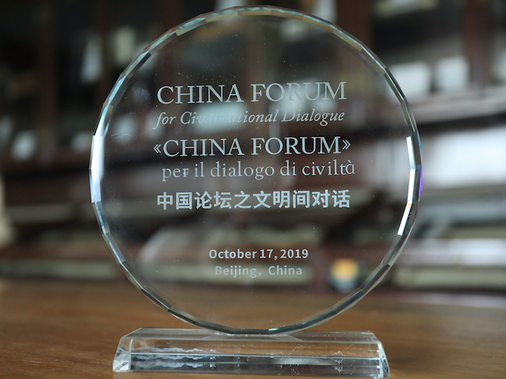 Award given to forum panelists and participants pictured.