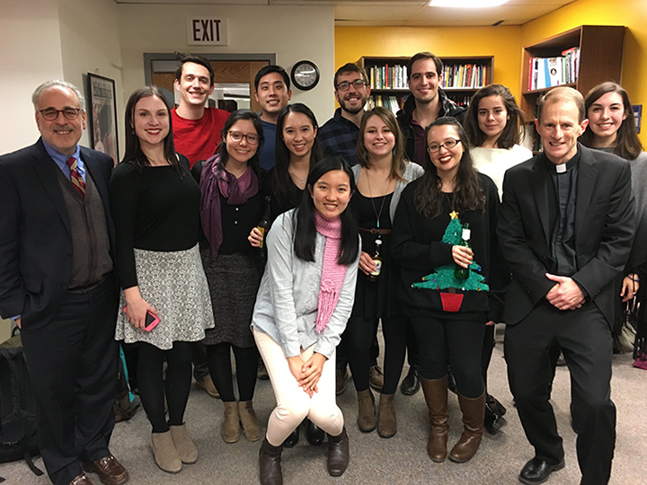 Marc Chernick with CLAS students and Fr. Matthew Carnes at CLAS Holiday Party 2017