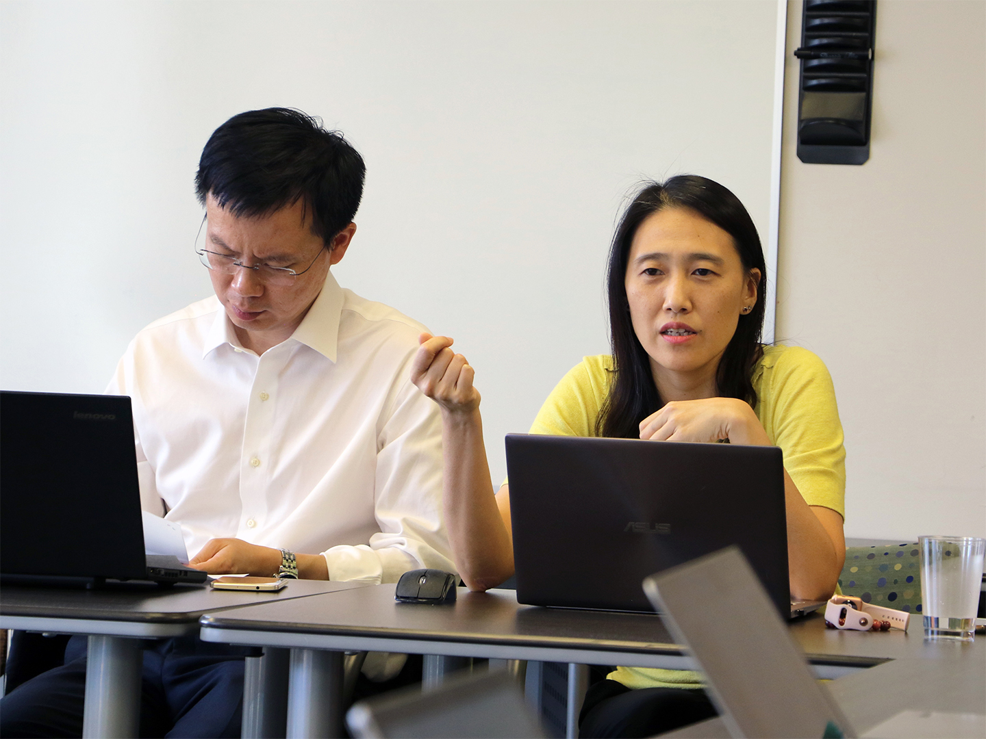 Han-Mei Tso sharing information about her research with Can Huang