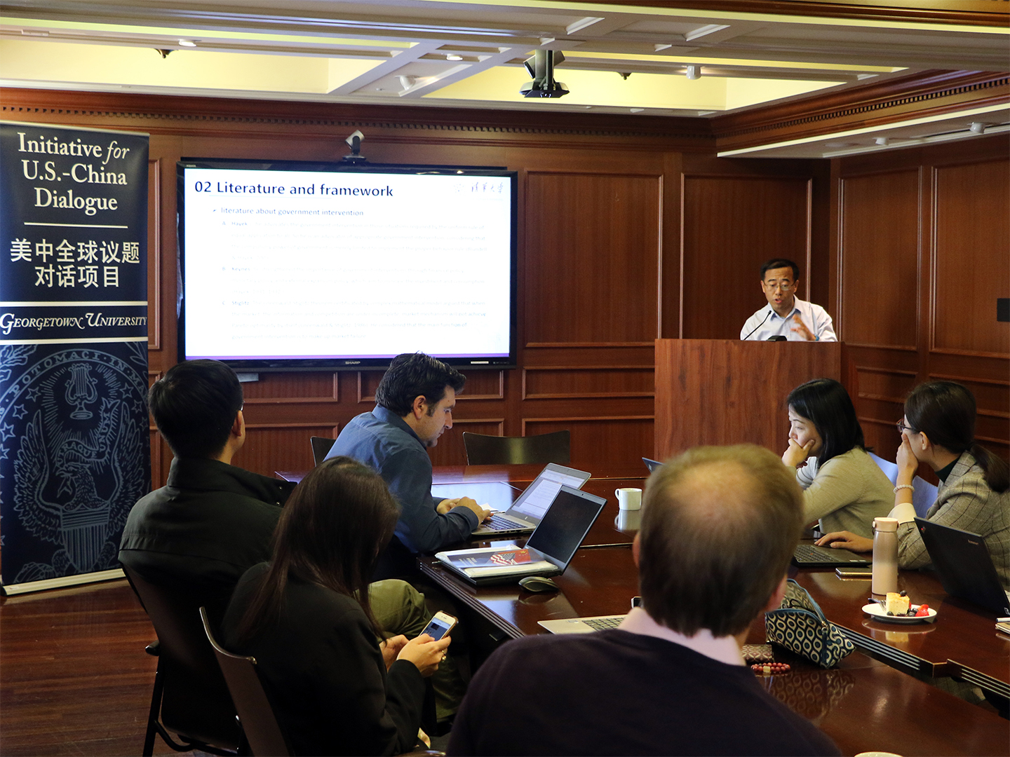 Liang Zheng sharing his research with the group