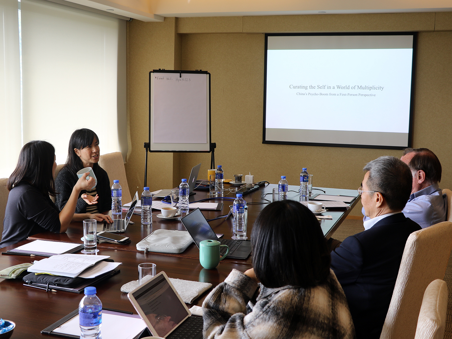 Teresa Kuan introducing her research to the group.