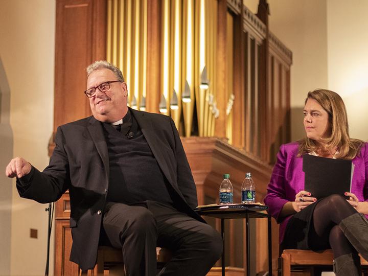 Panelists speak in Dahlgren Chapel