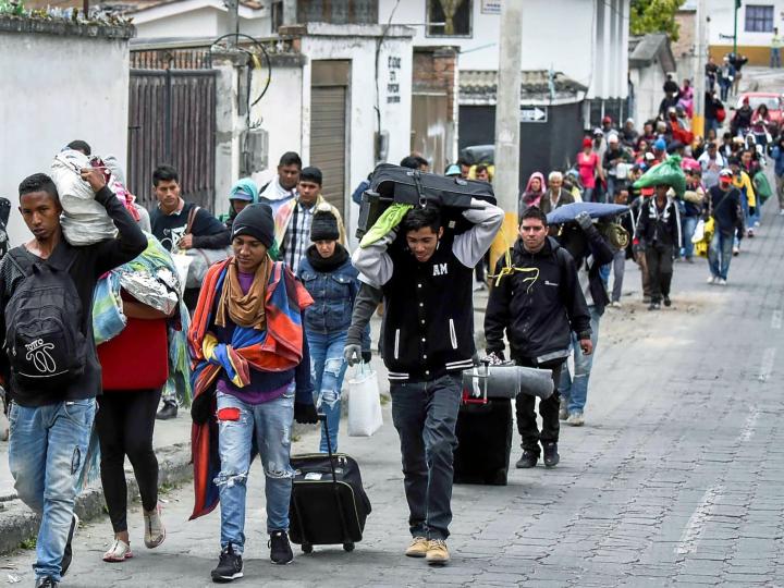 Venezuelan marching towards Peru through the streets of Tulcan. Ecuador, after crossing Colombia. LUIS ROBAYO AFP