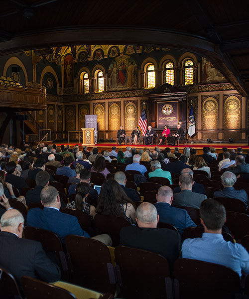 View of panel discussion in Gaston Hall at Georgetown University