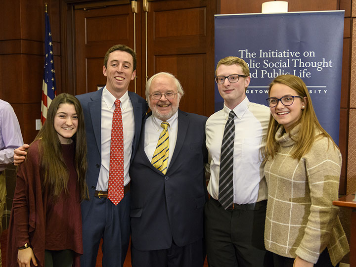 John Carr, director of the Initiative, and young leaders at an Initiative dialogue.