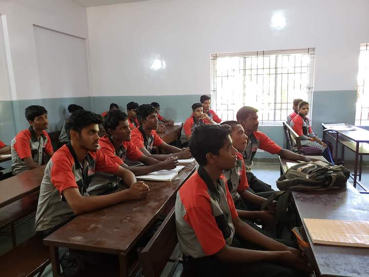 Students in a motorcycle repair class in Chennai, India.