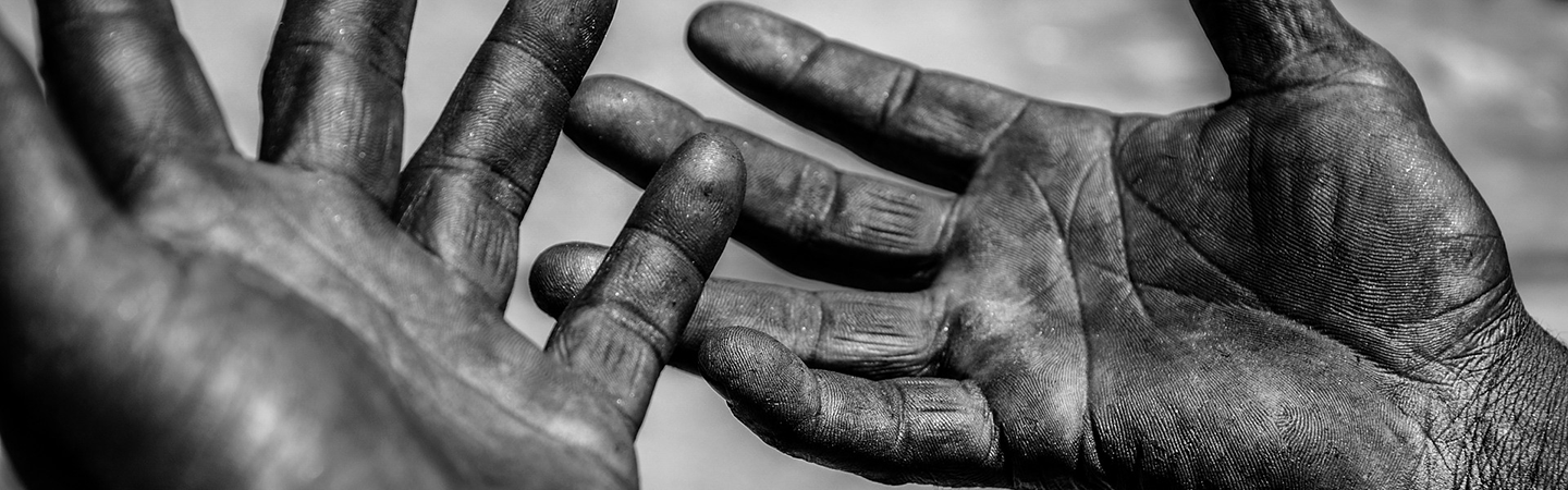 Hands of worker outstreched