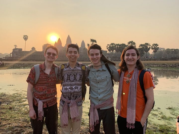 "Students in the class ""Politics and Performance"" standing in front of the Angkor Wat temple in Cambodia."